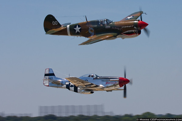 May 30 - Chris Baranaskas in the P-51 and Dan Dameo in the P-40 return from Jones Beach during the Memorial Day Weekend air show