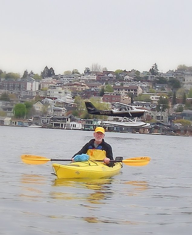 Sea planes lands behind us as we kayak on Lake Union