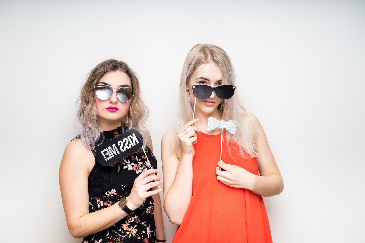 happy ladies girls female with fancy dress photo booth props smile party white isolated background