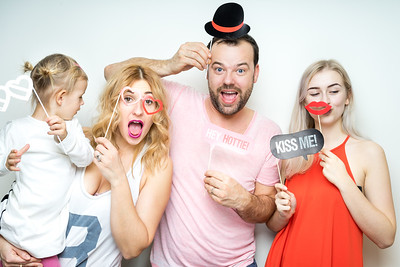 happy smile family dad mom daughter baby sitter strike a pose party photo booth props laugh