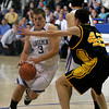 St. Michael's Patrick Griswold, #3 dribbles around St. Pius John Doughty, #42 during the second quarter of their game at St. Michael's on Friday, January 15, 2009.  St. Mikes up 43-38 in the 4th quarter.<br /> Photos by Jane Phillips/The New Mexican