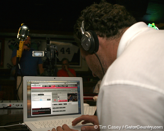 photo by Tim Casey<br /> <br /> Gator Country Video Director Brenden Martin works on the live internet broadcast during the seventh Gator Country Caravan stop on Tuesday, July 29, 2008 at the Press Box Sports Bar in Tampa, Fla.