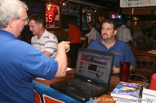 photo by Tim Casey<br /> <br /> Gator Country Advertising Director James Irvine speaks with a guest during the seventh Gator Country Caravan stop on Tuesday, July 29, 2008 at the Press Box Sports Bar in Tampa, Fla.