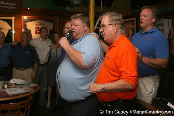 "photo by Tim Casey<br /> <br /> Gator Country Recruiting Coordinator ""Hollywood"" Bob Redman sings as guests swing and sway to ""We Are the Boys"" during the seventh Gator Country Caravan stop on Tuesday, July 29, 2008 at the Press Box Sports Bar in Tampa, Fla."