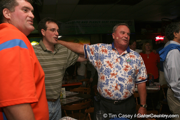 """photo by Tim Casey<br /> <br /> Guests swing and sway to """"We Are the Boys"""" during the seventh Gator Country Caravan stop on Tuesday, July 29, 2008 at the Press Box Sports Bar in Tampa, Fla."""