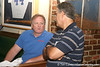 photo by Tim Casey<br /> <br /> Gator Country Senior Columnist/Radio Host Mark McLeod speaks with a guest during the seventh Gator Country Caravan stop on Tuesday, July 29, 2008 at the Press Box Sports Bar in Tampa, Fla.