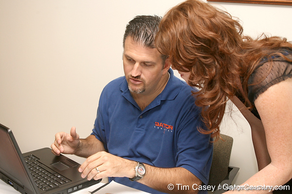 photo by Tim Casey<br /> <br /> Gator Country Advertising Director helps to sign up a new Gator Country subscriber during the Marion County Gator Club's Gator Gathering (and ninth stop of the Gator Country Caravan) on Thursday, July 31, 2008 at Central Florida Community College in Ocala, Fla.