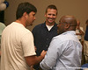 photo by Tim Casey<br /> <br /> WMOP/WGGG radio host Adam Reardon speaks with a guest at the Marion County Gator Club's Gator Gathering (and ninth stop of the Gator Country Caravan) on Thursday, July 31, 2008 at Central Florida Community College in Ocala, Fla.