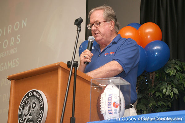 photo by Tim Casey<br /> <br /> Gator Country Executive Editor Buddy Martin speaks with guests during the Marion County Gator Club's Gator Gathering (and ninth stop of the Gator Country Caravan) on Thursday, July 31, 2008 at Central Florida Community College in Ocala, Fla.