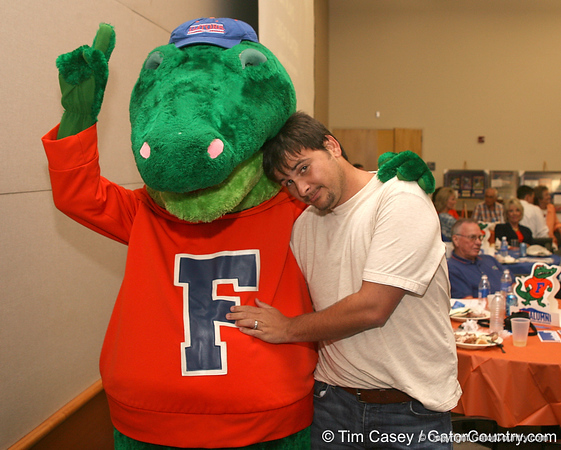 photo by Tim Casey<br /> <br /> Albert the Alligator and radio show host Adam Reardon pose for a photo during the Marion County Gator Club's Gator Gathering (and ninth stop of the Gator Country Caravan) on Thursday, July 31, 2008 at Central Florida Community College in Ocala, Fla.