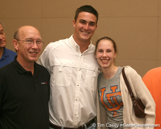 photo by Tim Casey<br /> <br /> Florida redshirt quarterback John Brantley poses for a photo with Glenn and Ruth Tamblingson at the Marion County Gator Club's Gator Gathering (and ninth stop of the Gator Country Caravan) on Thursday, July 31, 2008 at Central Florida Community College in Ocala, Fla.