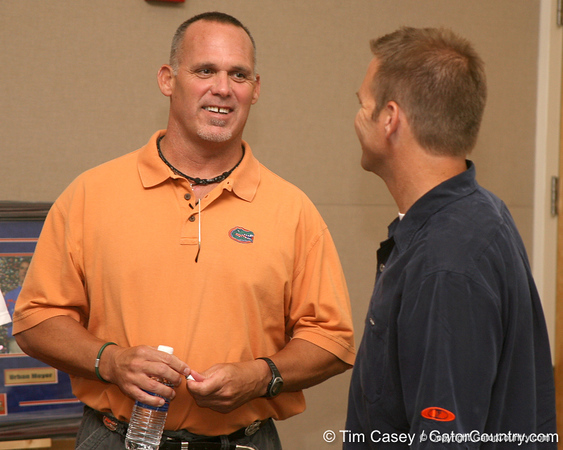photo by Tim Casey<br /> <br /> Florida football great and Tampa radio host Scot Brantley speaks with Brady Ackerman during the Marion County Gator Club's Gator Gathering (and ninth stop of the Gator Country Caravan) on Thursday, July 31, 2008 at Central Florida Community College in Ocala, Fla.