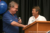 """photo by Tim Casey<br /> <br /> Gator Country Executive Editor Buddy Martin presents the """"Gator of the Year"""" award during the Marion County Gator Club's Gator Gathering (and ninth stop of the Gator Country Caravan) on Thursday, July 31, 2008 at Central Florida Community College in Ocala, Fla."""