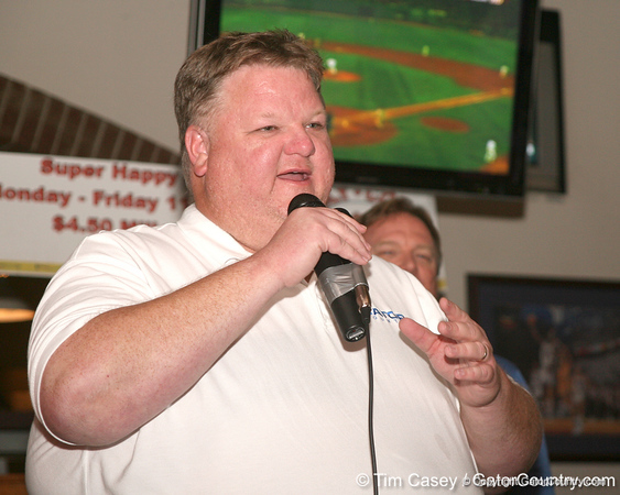 "photo by Tim Casey<br /> <br /> Gator Country Recruiting Coordinator ""Hollywood"" Bob Redman speaks with guests during the eighth stop of the Gator Country Caravan on Wednesday, July 30, 2008 at the Friendly Confines Sports Restaurant in Winter Park, Fla."