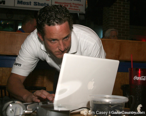 photo by Tim Casey<br /> <br /> Gator Country Video Director Brenden Martin prepares to broadcast on the internet during the eighth stop of the Gator Country Caravan on Wednesday, July 30, 2008 at the Friendly Confines Sports Restaurant in Winter Park, Fla.