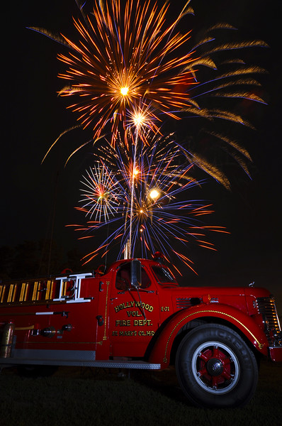 """4th of July,   Hollywood VFD had a very nice 4th celebration at their firehouse.  They held a car show, a band, and fireworks.  John mentioned getting the firetruck and fireworks in one shot, and I tweaked things a little to get this image.  I really wasn't that excited about shooting this evening.  We were supposed to shoot for the production group at the Trace Adkins concert, but once there were told """"no cameras on the in field'.  So instead of shooting from the stands, 120 feet away, we left.   Oh well, I got a cool shot of a firetruck on the 4th instead!  I'm happy."""