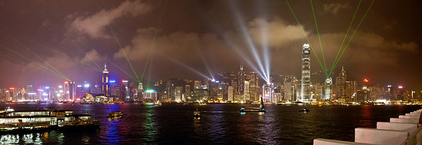 Hong Kong Harbor during their nightly Light Show.  If you've ever been to Hong Kong you know the breadth of the harbor. To achieve this panorama I stitched two photos together. Other than the stitching this photograph is NOT enhanced in any way.