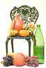 A still life of some grapes and squash along with a large peach around a tiny chair.