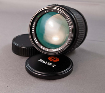 This is a Phase 2 lens, 135mm f/2.8. It doesn't focus to infinity. It focuses out to about 15 yards or so. Otherwise it is in mechanically and optically good shape. Aperture functions normally. It has a manual aperture ring with clicks at full stop from 2.8 to 16. Comes with original front and rear caps.