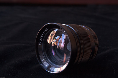 """Vivitar 28/2.5 lens with an M42 mount. It has a preset aperture, but you must manually stop it down using a freely-rotating ring. Aperture is oil free - """"snappiness"""" is not an issue since it isn't an auto aperture.   Lens is in optically good condition - no marks on the glass. The body is well-ised, with lots of brassing and some nicks and scratches. It's not a collector's item, but could make a good user. Comes with the original slip on cap - someone covered over the Vivitar logo with masking tape a long time ago - I haven't tried to take it off. Comes with a rear cap - not sure if it's generic or original."""