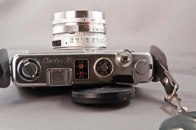 Yashica Electro GS camera with fixed 45mm f/1.7 lens and strap. Lens is optically in excellent condition. Body appears to work as intended. There is no corrosion in the battery compartment. I don't have a battery for it, so I haven't tested the meter. Also don't have film for it, so I cannot vouch for the condition of the light seals.   Cosmetically, the body and lens are in excellent condition, with very small wear marks.   Comes with original user's manual.