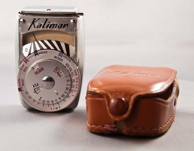 Kalimar A-1 light meter with fitted leather case. Seems to work fine - the needle moves anyway. But I don't know how to work it so I can't tell if it's accurate or not.
