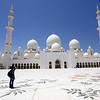 "Sheikh Zayed Mosque in Abu Dhabi is the largest mosque in the United Arab Emirates and the sixth largest mosque in the world. It is named after Sheikh Zayed bin Sultan Al Nahyan, the founder and the first President of the United Arab Emirates, who is also buried there. The mosque was officially opened in the Islamic month of Ramadan in 2007.  Although it is illegal for non-Muslims to enter mosques in the United Arab Emirates, this mosque will be an exception. The Abu Dhabi Tourism Authority announced that tours of the mosques will be given to both Muslims and non-Muslims beginning in mid-March 2008 in order to promote cultural and religious understanding.[  The Sheikh Zayed Mosque made some world records:  The carpet laid out on the vast expanse is the ""World's Largest Carpet"" made by Iran's Carpet Company and designed by Iranian artist Ali Khaliqi. This carpet measures 5,627 m2 (60,570 sq ft), and was made by around 1,200 weavers, 20 technicians, and 30 workers. The weight of this carpet is 47 tons – 35 tons of wool, and 12 tons of cotton. There are 2,268,000 knots within the carpet.   This mosque also holds the largest chandelier. There are seven imported chandeliers from Germany and are copper and gold-plated. The largest chandelier has a 10 m (33 ft) diameter and a 15 m (49 ft) height.   Both of these records were previously held by the Sultan Qaboos Grand Mosque in Oman.  Ref.: en.wikipedia.org/wiki/Sheikh_Zayed_Mosque"