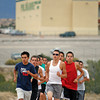 James Viarreal, a senior at Pojoaque High School, front right, runs with the rest of the boys cross country team during practice at Pojoaque High School on Oct. 20, 2009.        (Luis Sanchez Saturno/The New Mexican)