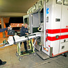 Mike Suber, a paramedic at Fire Station 8, and Ty Wilfon, an EMT-I, put their equipment away after transporting a child had lodge a small object in her nose on Oct. 20, 2009, to St. Vincent's Hospital. The city is just weeks away from approving the first of three phases of annexation. A vote this month would finalize the first 1,900 acres to be annexed, and most agree the city is prepared to take on that area. However, the second phase  will mean big changes.        (Luis Sanchez Saturno/The New Mexican)