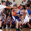 (42)(L) and (13)(R) of Santa Fe Indian School try to take the ball from (31)(C) Corey Johnson of Laguna-Acoma, during a boys basketball game on Nov. 19, 2009. The Braves won,       .<br />  Natalie Guillen/The New Mexican