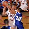 (42) of Santa Fe Indian School tries to shoot over (20) of Laguna-Acoma during a boys basketball game on Nov. 19, 2009. <br />  Natalie Guillen/The New Mexican
