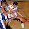 (32) of Santa Fe Indian School keeps the ball from Laguna-Acoma, during a boys basketball game on Nov. 19, 2009. The Braves won,       .<br />  Natalie Guillen/The New Mexican