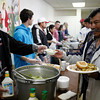 Volunteers at Guadalupe Church serve a thanksgiving meal to anyone who comes by on Nov. 26, 2009.<br />  Natalie Guillen/The New Mexican