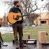 Clay Lynch, 35, from Eureka Springs, Arkansas waits for an audience on the Plaza to raise money to save his bus in Santa Fe, N.M. on Dec. 7th, 2009. The bus has been booted because he has acquired $194 worth of parking tickets. <br /> Leigh Fagerstrom/The New Mexican