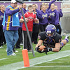 Pat Christman<br /> Minnesota State's football team had a difficult and amazing year. While I had many good photos of the team, I like this one of Andy Pfeiffer not only for the dive into the end zone, but the reaction of the dance team, ball boy and down marker official on the sideline behind him.