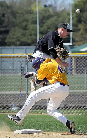 John Cross<br /> Capturing a different moment in sports always is a challenge, particularly during a baseball game. A collision between Minnesota State's Lucas Skjefte and Wayne State's Brett Keim at first base provided a different view of the game.