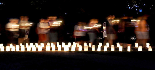 Pat Christman<br /> I was actually done shooting the Blue Earth County Relay For Life for the next day's paper when I made this photo of walkers on a candlelit silent lap. I called the office and asked if I could still make deadline. Fortunately for me it wasn't too late.