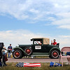 Spectators admired an antique car as it crept along Brown County Highway 6 leading into Godahl during that tiny community's annual Labor Day celebration and parade.<br /> The stars-and-stripes chair bag provided a perfect exclamation point to the quintessential, American holiday.