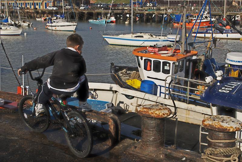 A young boy dreams of the sea  in Bridlington Harbour October 2009