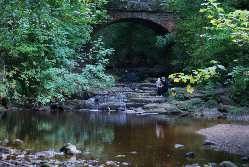 A quiet moment for two under the old bridge above Falling Foss waterfall, North yorks, England