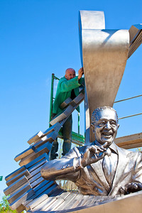 Duke Ellington Sculptor putting finishing touches on the sculpture in Shaw