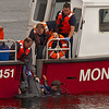Rescue team pulling drowned diver from the water off of San Carlos Beach near the breakwater, Monterey California
