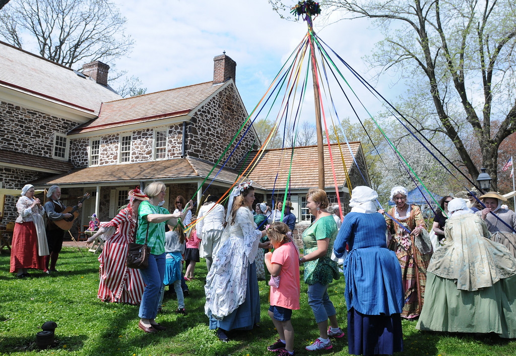 . Dancing around the May pole at the Colonial May Fair held at Pottsgrove Manor . Two of John Potts decendents Annette Burnett in green shirt center of photo and her daughter Skylar Christman, orange shirt both of Virginia were in Pottstown. Burnett said that John Potts is her seven times great grandfather. Photo by John Strickler The Mercury