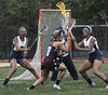 Pottsgrove #2 tries to cut toward the goal as Pottstown #13 and 7defend in first half action. Photo by John Strickler/The Mercury