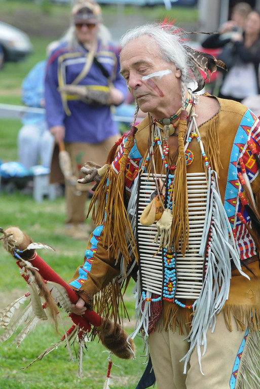 . Johnny White Bull whose spirit is with the Cheyene nation takes part in men\'s traditional dance during the pow wow held at Memorial Park Saturday. Photo by John Strickler The Mercury
