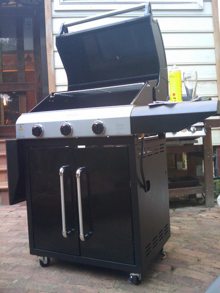 New bbq assembled and seasoned, ready for tonight's dinner of dill & lemon snapper with grilled sweet potato and onion