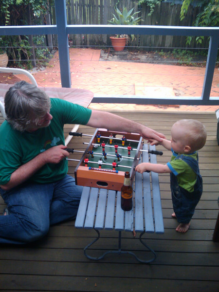 Liam and Ben playing foosball