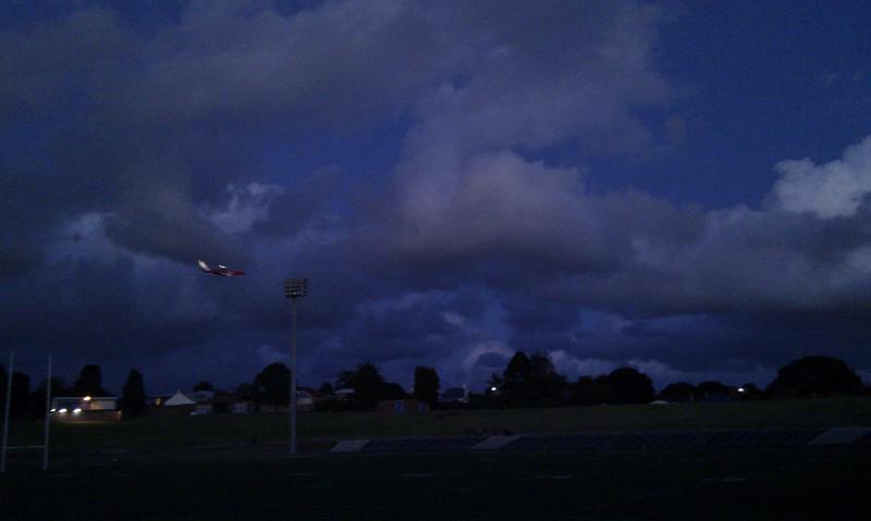 Brooding skies and plane