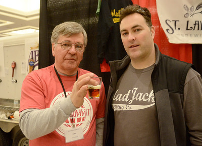 Ed Burke - The Saratogian02/22/14 John Fura holds a glass of Fightin' Irwin IPA from Schenectady's Mad Jack Brewery as he stands with brewery owner Billy McDonald during Saturday's Saratoga Beer Summit at the city center.