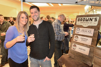 Ed Burke - The Saratogian02/22/14 Jason Metzger of Saratoga and Jessica Carman of Albany enjoy themselves during Saturday's Saratoga Beer Summit at the city center.